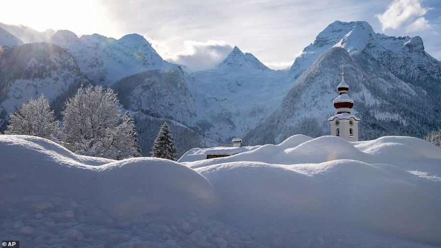The steeple of the Loferer church is seen peeking above the snow the snow in Lofer, Austrian province of Salzburg