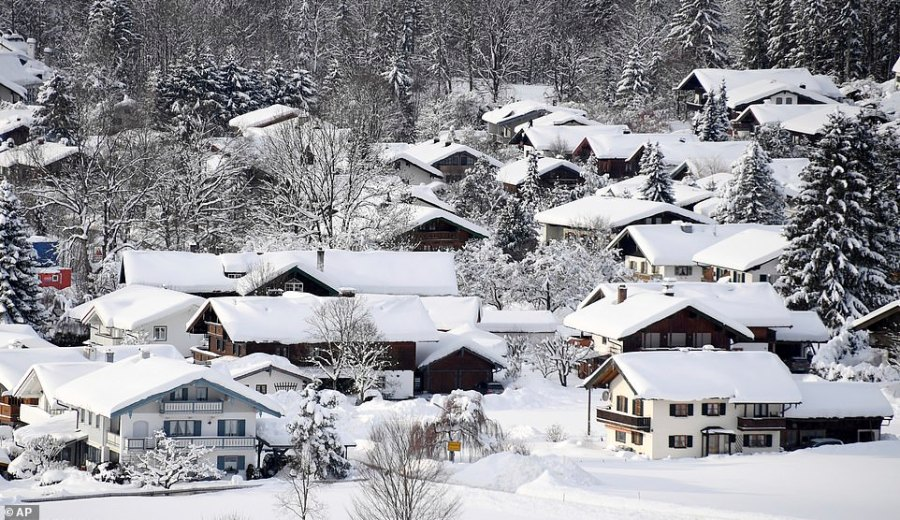Snow covered the buildings of the village Ruhpolding, Germany, which has been inundated with the white stuff