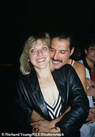 Mary Austin (left) and Freddie Mercury (right) pictured smiling at his 38th birthday party