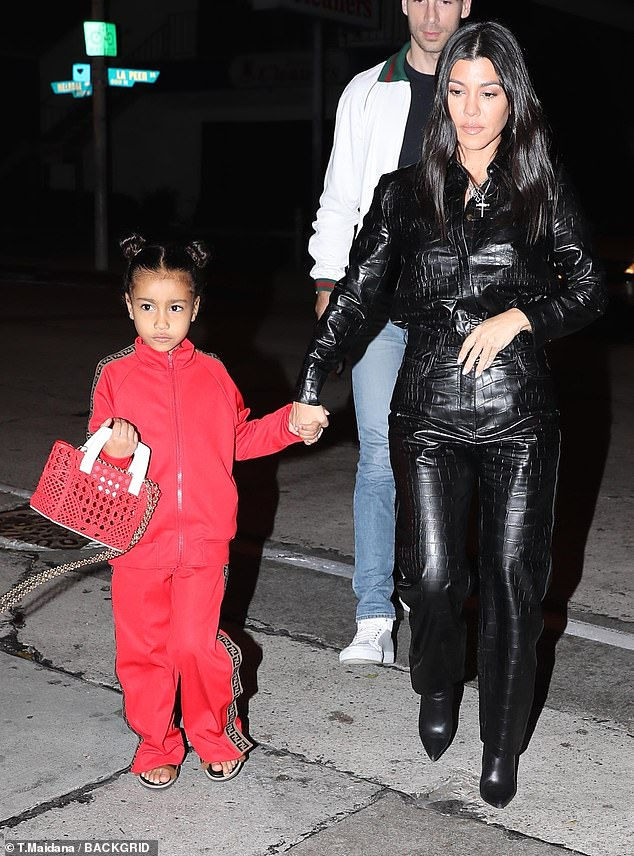 Dinner: his nephew North wore a red suit by Fendi, while he was wearing a red bag
