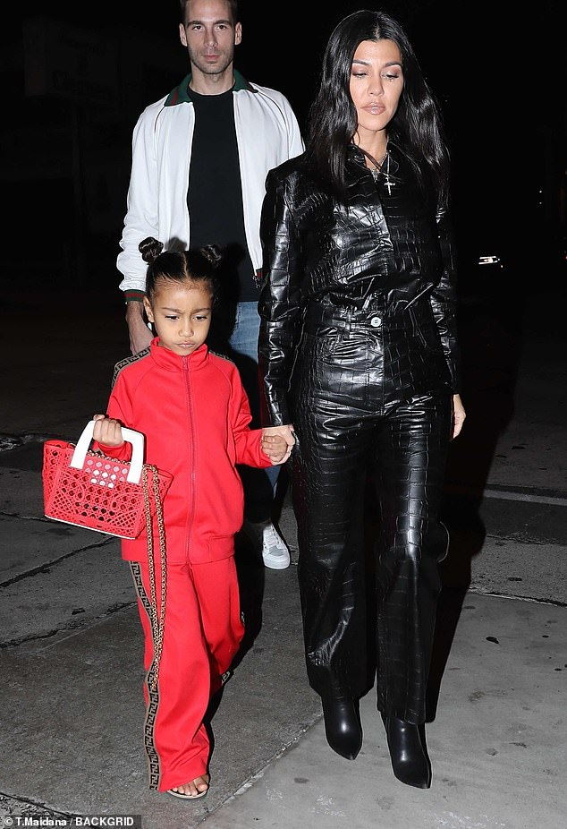Dinner time: the five-year-old girl initially made a lovely entrance to the restaurant with her aunt Kourtney Kardashian, 39, in a red suit by Fendi while she was wearing a matching red handbag