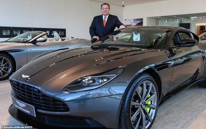 Obwohl Aston Martin einen zweiten Preis in Höhe von 160.000 £ erhielt, verkaufte das Ehepaar (Bild) nur 30.000 Tickets und generierte 750.000 £ - ein Viertel des Wertes des Sechs-Bett-Hauses - und das Auto soll auch bei ihnen bleiben