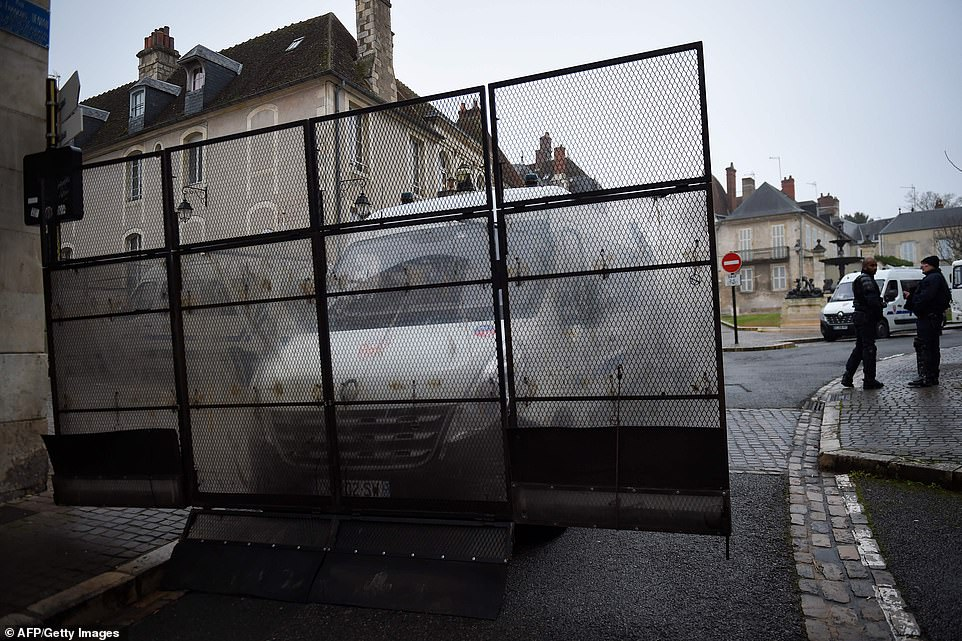 """French anti-riot police CRS stand guard by one of their vehicle equipped to form a dam in the streets of Bourgesahead of an anti-government demonstration called by the Yellow Vest """"Gilets Jaunes"""" movement"""