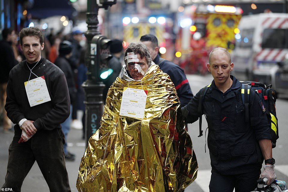 Rescuers assisted the walking wounded from the scene of the blast which is being blamed on a gas leak in a bakery