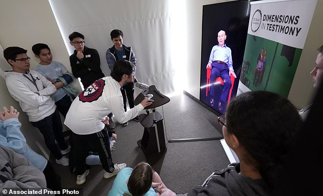 Interactive technology allows museum visitors to have a dialogue with survivors even after they're gone to 'learn from the world's mistakes'. The experience combines high-definition holographic interview recordings and voice recognition technology. Here, a student asks a question to Holocaust survivor William Morgan
