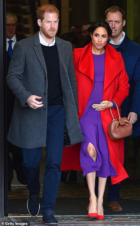 Meghan, 37, revealed that she is six months pregnant with her first child expected in April as she chatted to well-wishersin the northwest town of Birkenhead during her and Prince Harry's first joint engagement of the year.