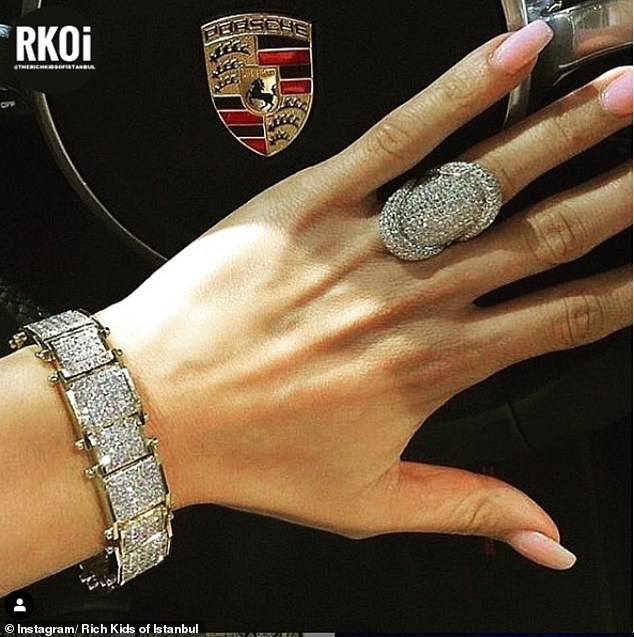 Nothing says high-end like a diamond ring and a bracelet to boot - and let's not forget the Porsche