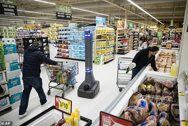 A robot named Marty cleans the floors in a huge supermarket in Harrisburg