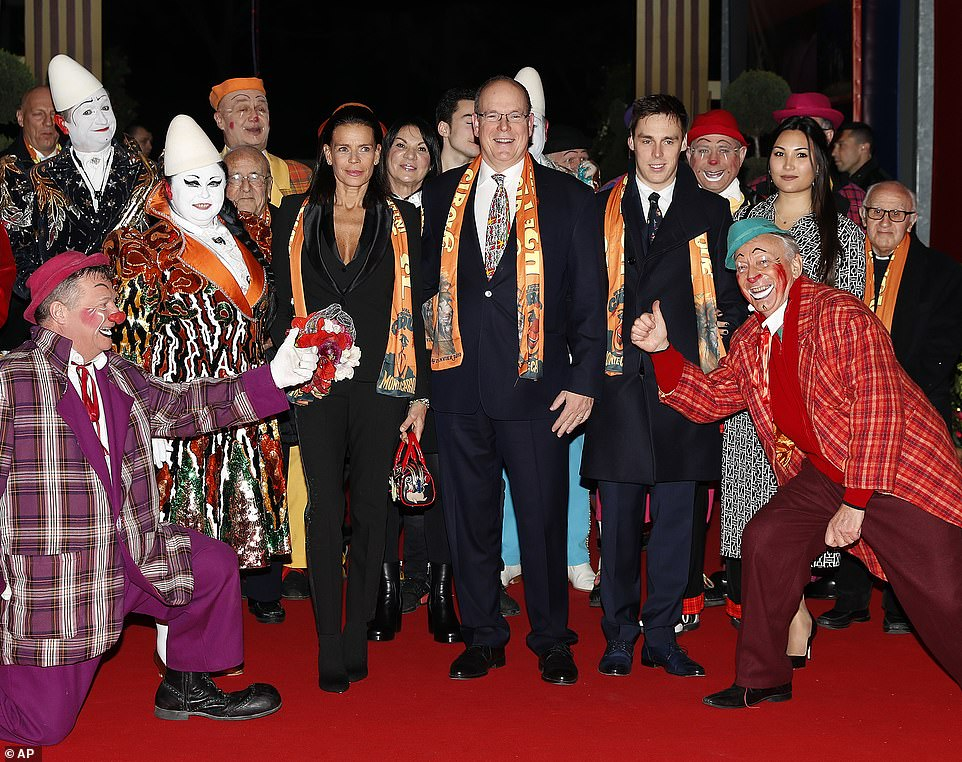 Monaco royals out in force! L-R: Princess Stéphanie, Prince Albert II, Stéphanie's son Louis Ducruet and his fiancée MarieHoa Chevallier with clowns and other performers at the Monte-Carlo International Circus Festival on Thursday. The four VIP guests, dressed head-to-toe in monochrome, beamed with delight as they posed with performers before the show kicked off