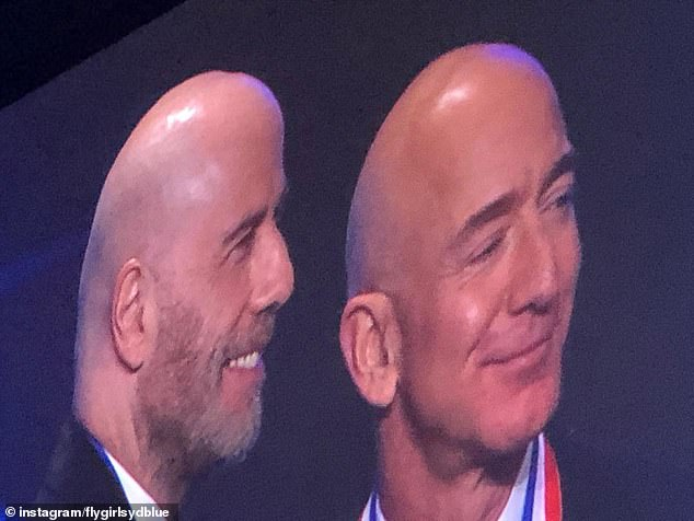 Awarded:The world's richest man, 55, became a Living Legend of Aviation as he was pictured with the actor on stage with a medal around his neck (L-R)