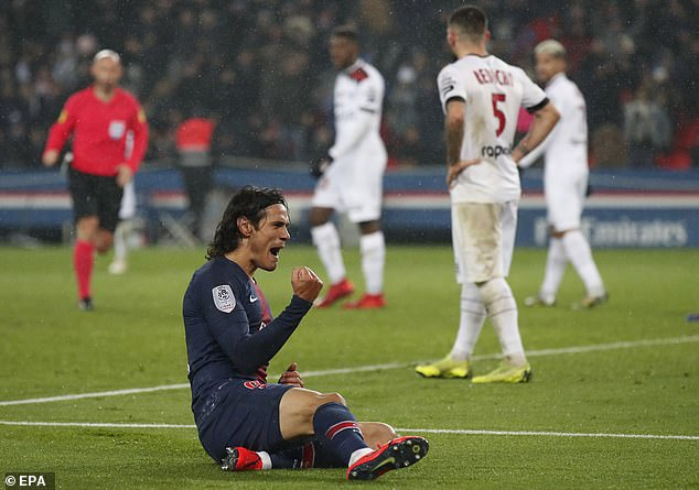 Uruguyan striker Cavani celebrates his hat-trick after tapping home his side's seventh