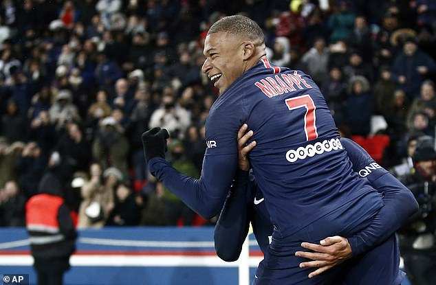 Mbappe celebrates with one of his team-mates during a convincing win for the Ligue 1 leaders