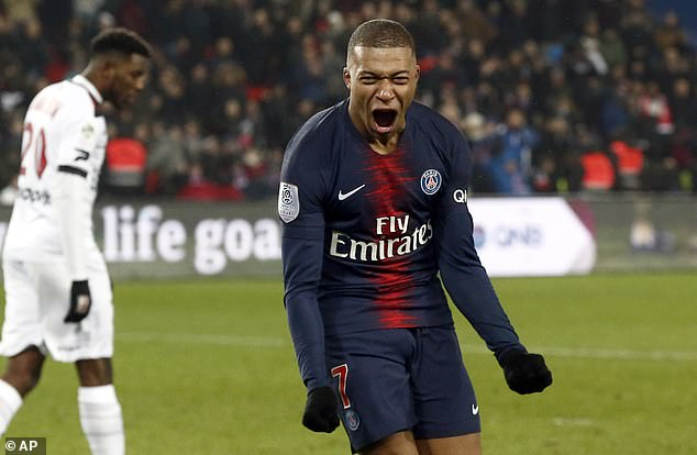 Kylian Mbappe celebrates after completing his hat-trick during a ruthless display for PSG