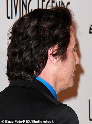 In January 2015, he tried out a longer style with a red tinge with sideburns, left