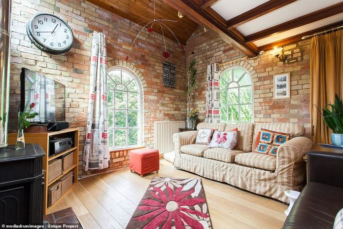 Bright rooms: The house has many bright spaces thanks to its large arched windows on its three floors.