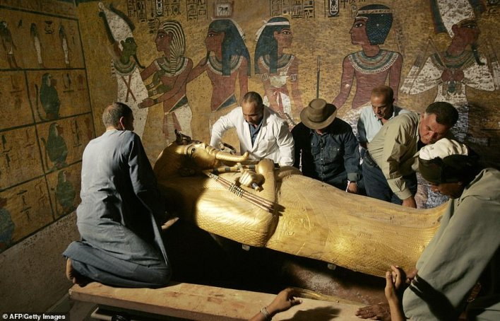 Egypt's antiquities chief Zahi Hawass (3rd L) supervises the removal of the lid of the sarcophagus of King Tutankhamun in his underground tomb in the famed Valley of the Kings in  2007.