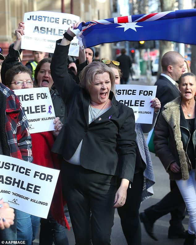 Siobhann Brown waves an Australian flag at a protest organised by the Australian Liberty Alliance outside the sentencing of Mohamed Naddaf over Ms Brown's daughter's death