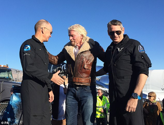 The 69-year-old (center)said he is training hard for the mission, and told CBS that his 'aim is to have the body of a 30-year-old' when he goes to space. Virgin Galactic is working along with Blue Origin, which also belongs to Branson on its way to sending passengers into space 'by 2020'