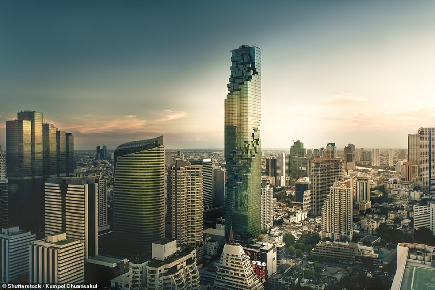 Game on: The King Power MahaNakhon is a bizarre skyscraper in Bangkok - and one of the tallest buildings in Thailand. It stands at 78 storeys high and opened in 2016, with architect Ole Scheeren among those that created the design. The cutaway parts of the building are meant to give the effect of it being pixelated