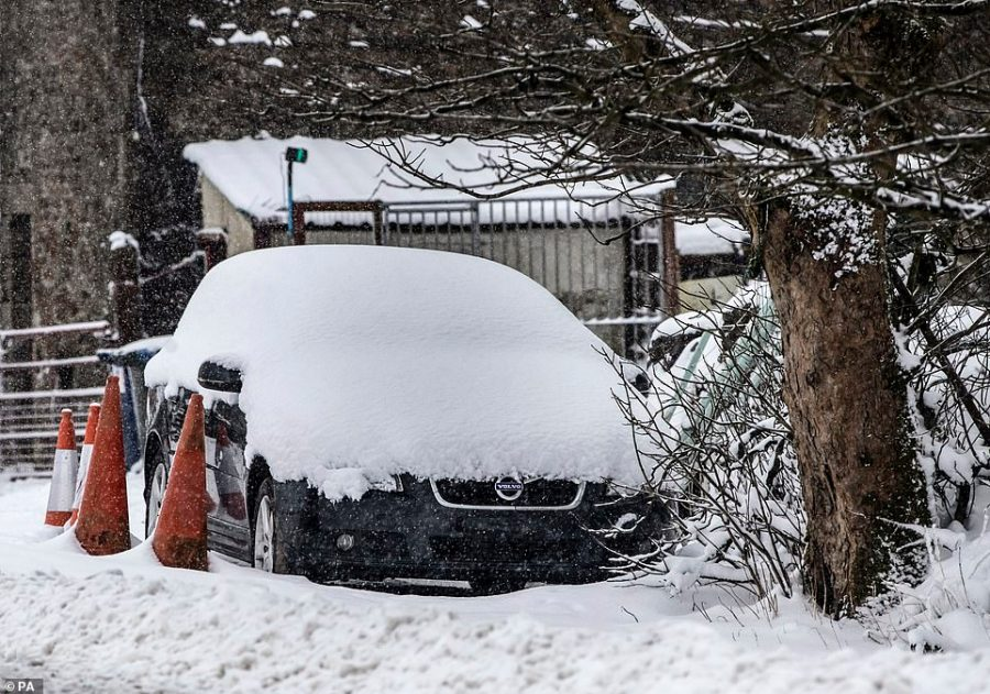 Simple mistake: Drivers are being told not to make this common error when trying to clear snow from their car, like this Volvo in North Yorkshire, where up to 10cm of snow could fall on higher ground as temperatures drop across the UK this week