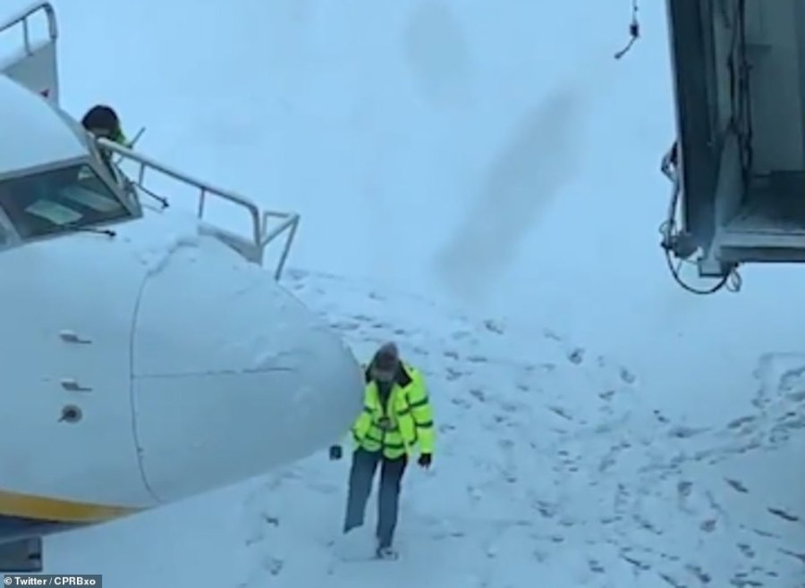 This worker at Manchester Airport was clearly intent on having at least a bit of fun yesterday