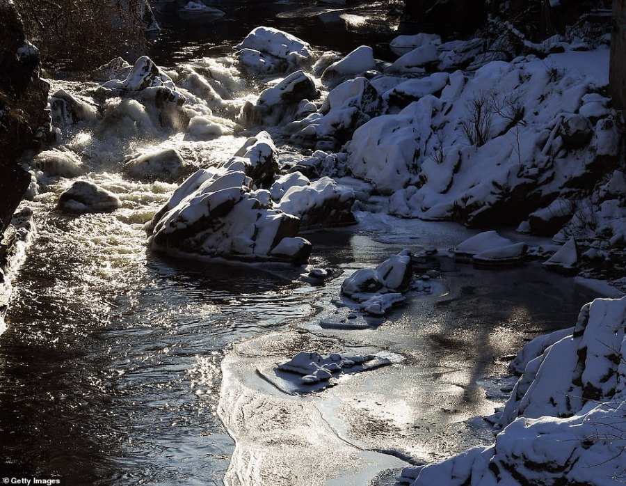 Partially frozen water on the River Clunie in Braemar, Aberdeenshire, today - where temperatures dropped to almost -15C