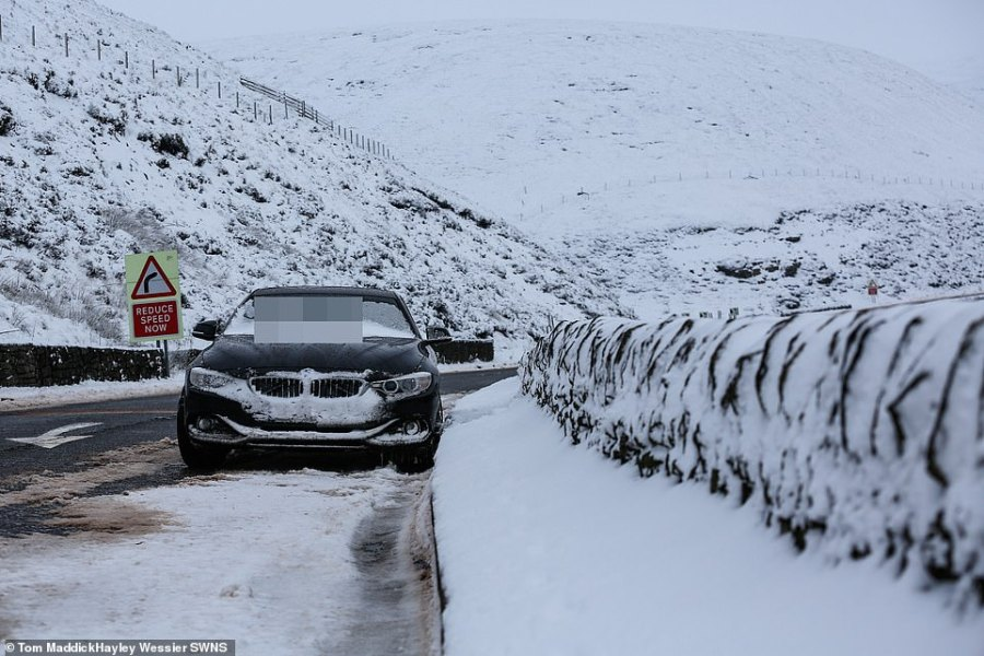 A BMW stuck on Snake Pass in Derbyshire this afternoon after the road was shut due to severe snow and ice