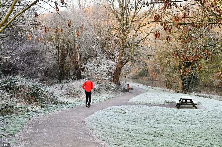 A jogger running by the River Avon in Bristol this morning after the UK had its coldest night of the winter so far