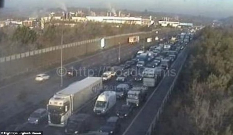 Police in Surrey warned of potentially deadly conditions on the roads after a lorry and two cars crashed on the M25 near Cobham (tailbacks pictured)