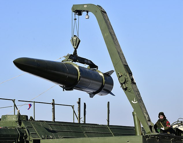 Deadly load: A quasi-ballistic missile being loaded into an Iskander-M system by Russian troops at a firing range