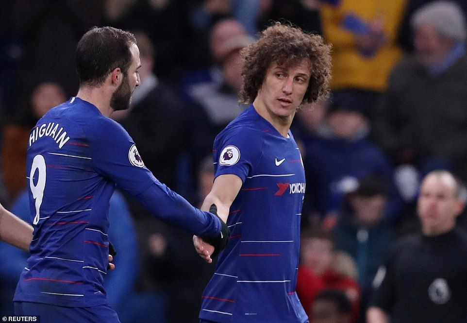 David Luiz shakes the hand of his new team-mate  Higuain after scoring his team's fifth and final goal of the match