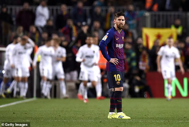 Messi looks bemused as Valencia race into a 2-0 lead against the La Liga champions