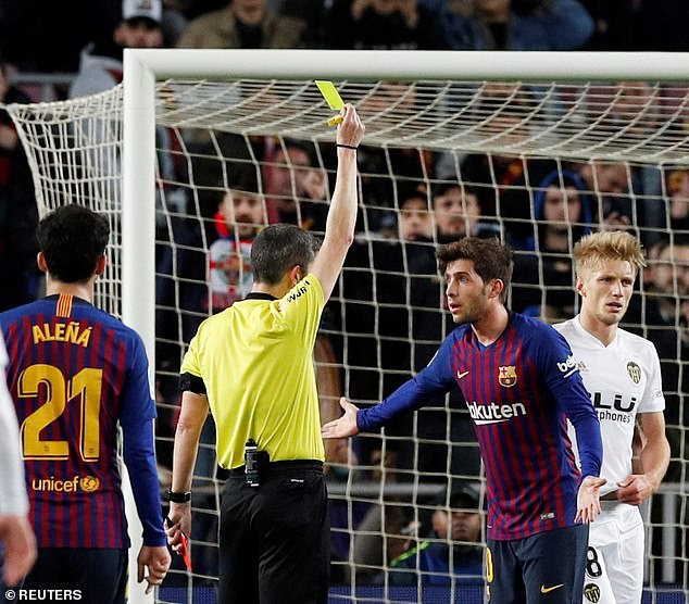 Barcelona defender Sergi Roberto is yellow carded after conceding a penalty in the first half