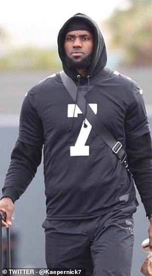 LeBron James dressed all in black with the limited edition shirt on