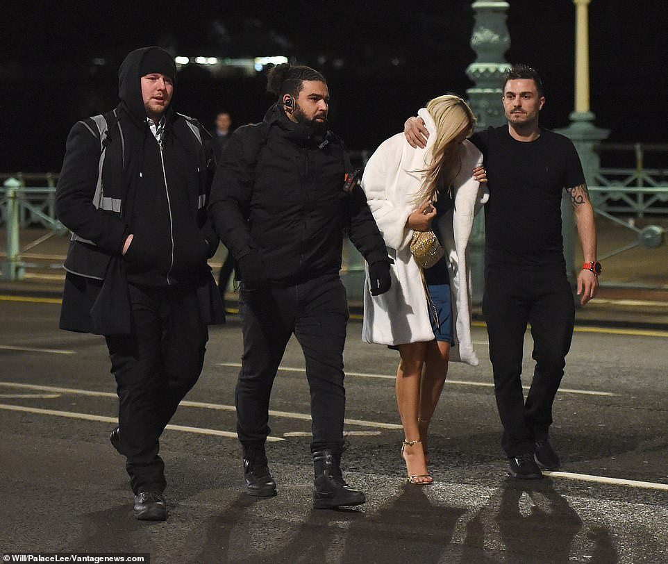 Home time: Megan was escorted by a male who was not a staff member as she left the venue