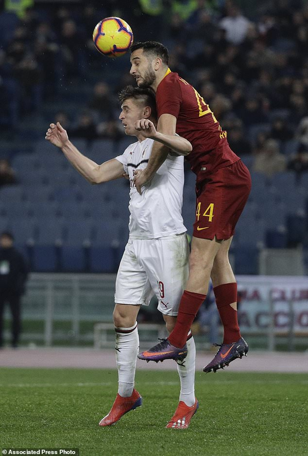 Roma's Kostas Manolas jumps over AC Milan's Krzysztof Piatek during the Serie A soccer match between Roma and AC Milan, at the Olympic Stadium in Rome, Sunday, Feb. 3, 2019. (AP Photo/Gregorio Borgia)