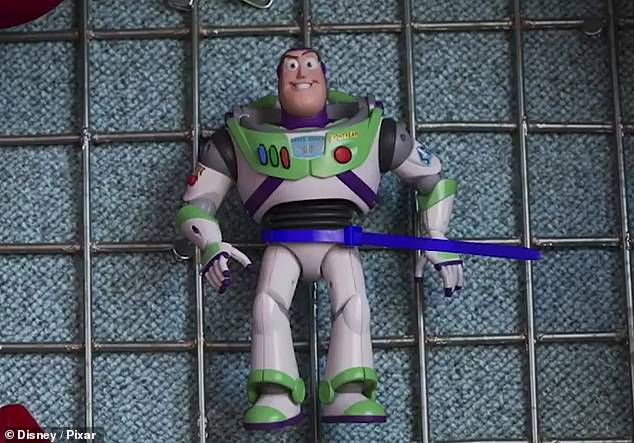 Buzz on the display: Buzz was actually stopped, where the trailer showed a man using a zip-tie to tie Buzz to a grid, making him appear as a toy that could be won from a carnival game