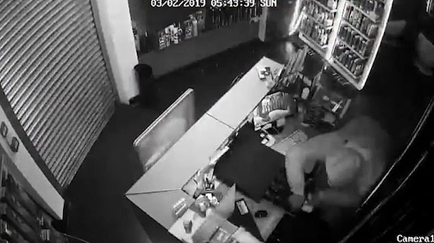 A metal security door is been closed over the entrance but the robbers manage to squeeze through a window in the back during the third robbery