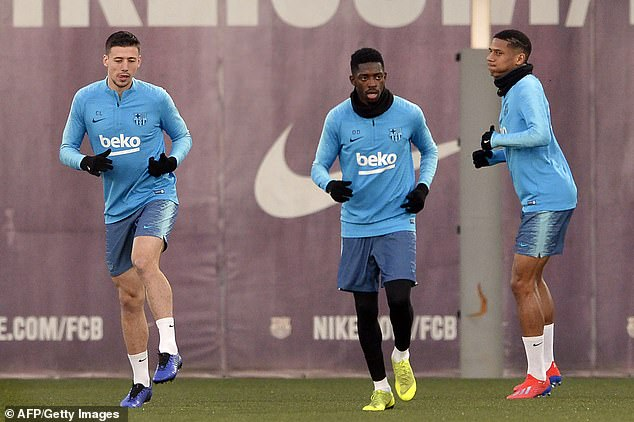 Clement Lenglet (left), Ousmane Dembele and Jean-Clair Todibo undertake their warm-up
