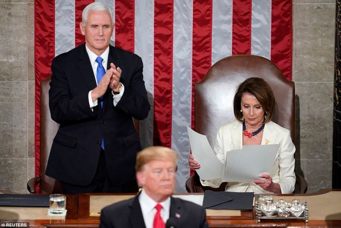 Vice President Pence gave Trump a standing ovation while Nancy Pelosi remained seated and looked through a copy of the speech