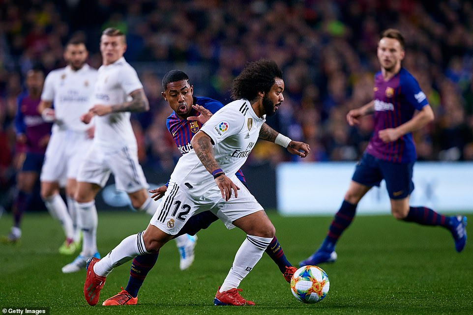 Marcelo brings the ball out of defence as he tries to find a way of getting Real Madrid back on the attack against Barcelona