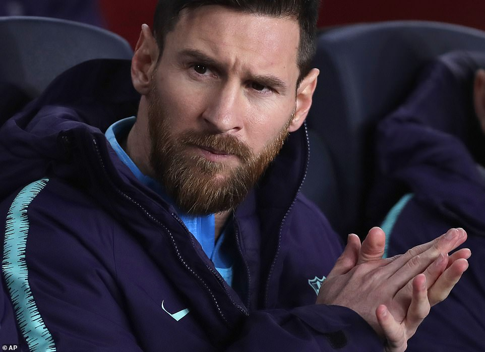 Messi does his best to cheer on his Barcelona team-mates despite being put behind by Vasquez's early strike for Real