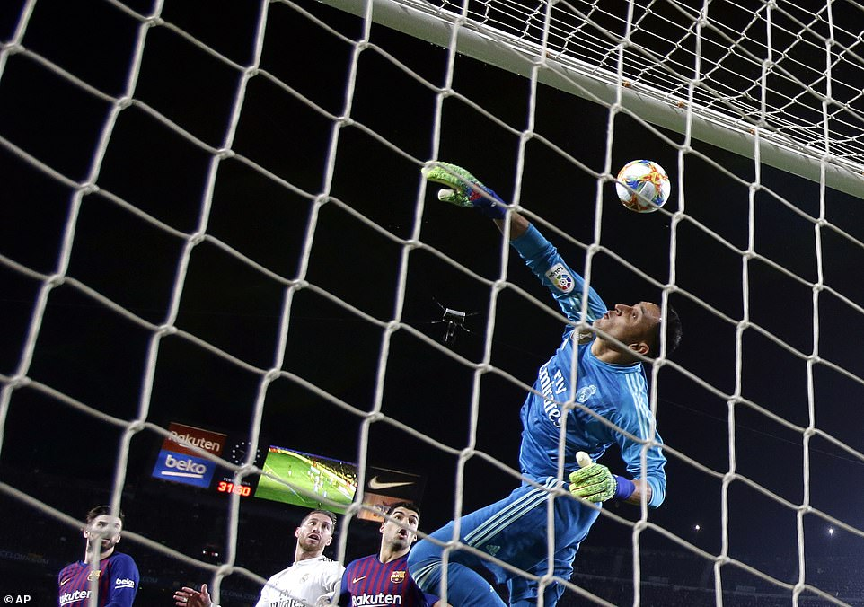Navas does excellently to make it to the ball and get a vital touch to send it safety as Barcelona pressed for an equaliser