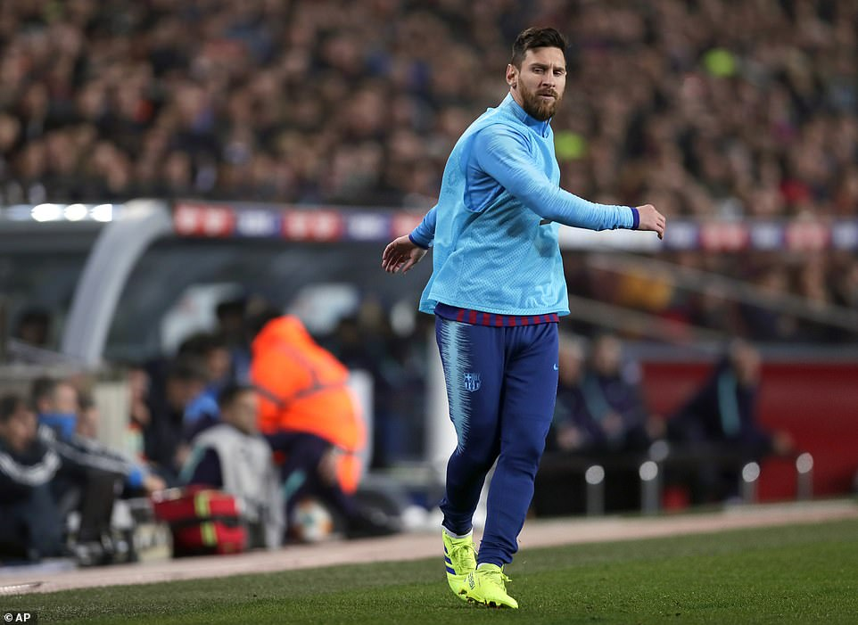 Messi warms up at the start of the second half as the Argentine prepares to come on in the Copa del Rey semi-final