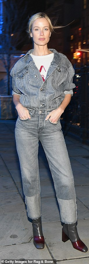 Carolyn Murphy shows off in gray overalls