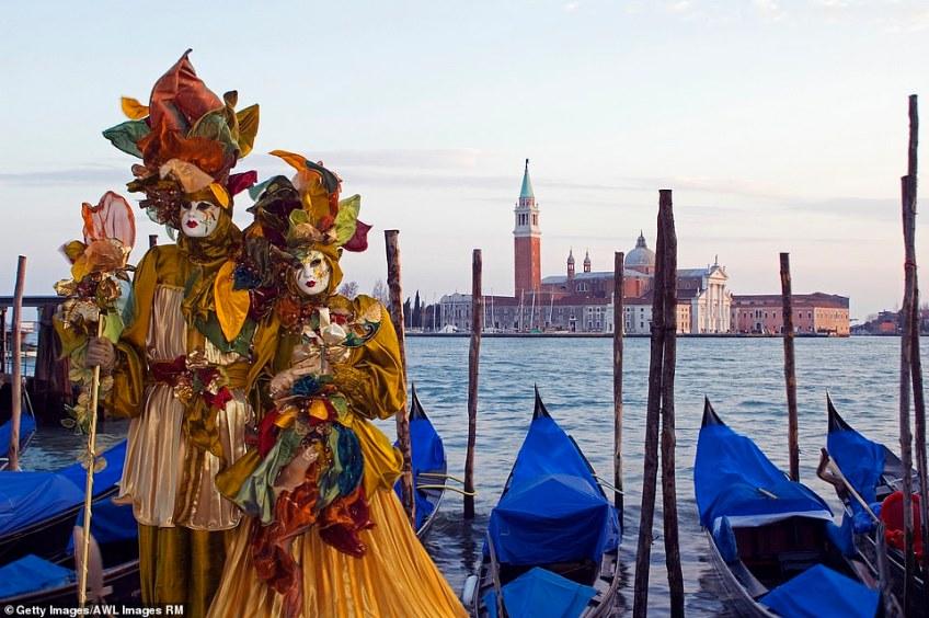 Elegant: The stars of Venice Carnival (above) wear elaborate costumes and beautiful Venetian masks