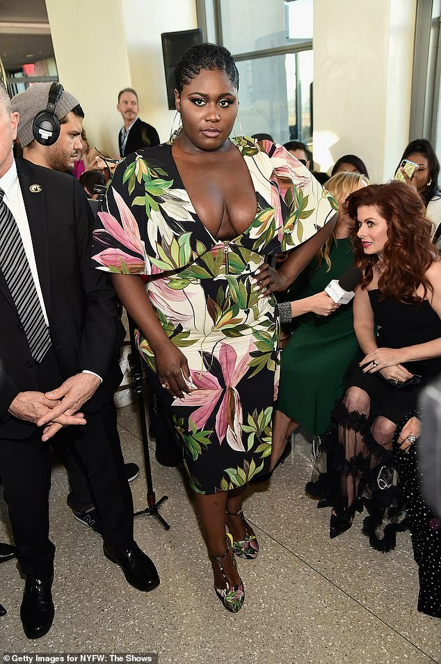 Ready for spring: Danielle Brooks of Orange Is The New Black fame flashed her cleavage in a cocktail dress that featured a colorful floral print over a black field