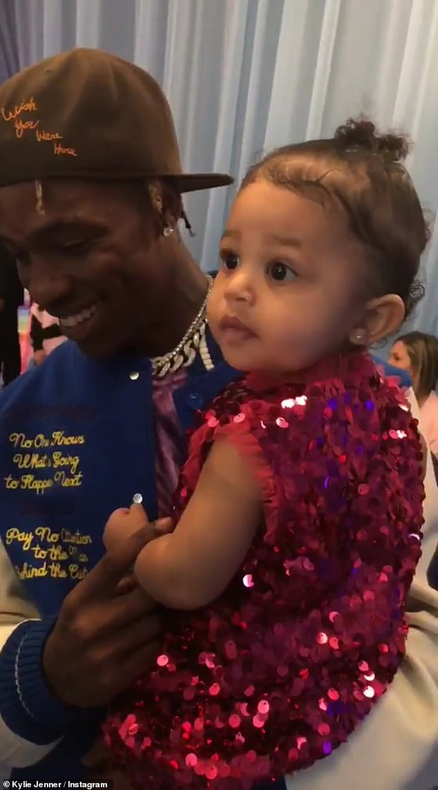 Pulling out all the stops: Kylie Jenner threw her daughter Stormi into an ultra-luxurious party to celebrate her birthday on Saturday. Above Stormi is seen with dad Travis Scott