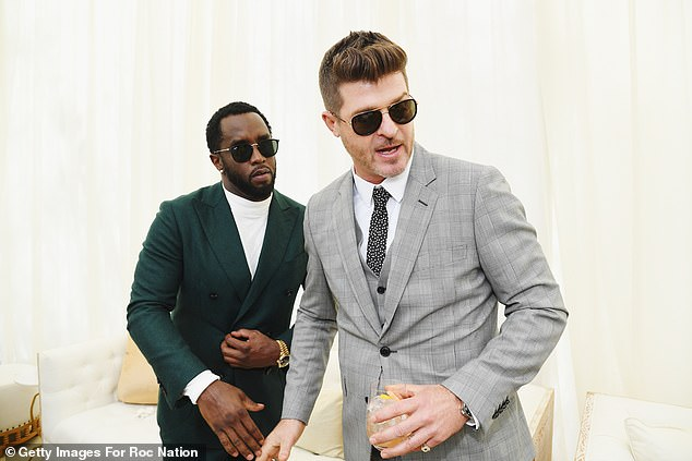 Hunk:Diddy was also glimpsed hobnobbing with Robin Thicke, who cut a dashing figure in a grey checked three-piece suit and charcoal tie