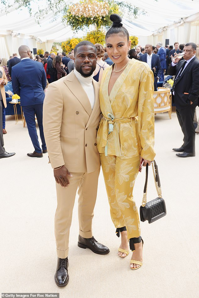 Fabulous:Eniko glowed in an autumnal chic trousers suit with a robe-like wrap top and a powder yellow leaf motif over a darker yellow field
